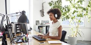 o-WOMAN-IN-HEADPHONES-IN-OFFICE-facebook